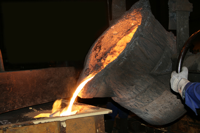 A worker in our foundry casting iron.